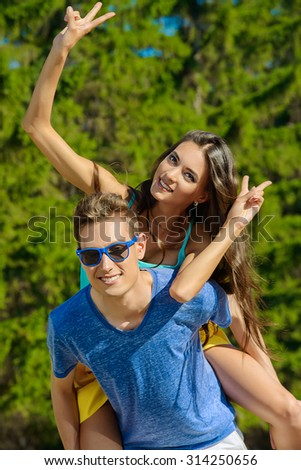 Cheerful couple in love having fun together. Happy summer day.  - stock photo