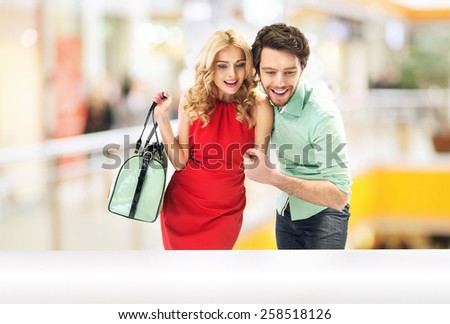 Cheerful couple on shopping trip - stock photo