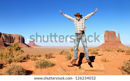 cheerful cowboy in monument Valley, Arizona, USA - stock photo