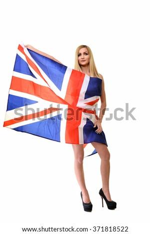 Cheerful cute English girl holding a flag - stock photo