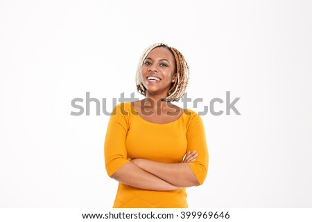 Cheerful cute lovely young african american woman standing with hands folded over white background - stock photo