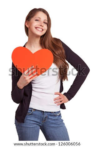 Cheerful dark-haired girl with a heart in his hands