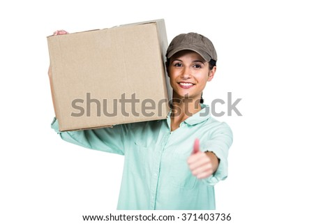 Cheerful delivery woman holding pack showing thumb up on white screen - stock photo