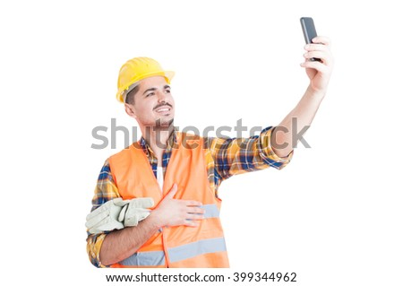 Cheerful engineer with yellow helmet taking a selfie as modern photograph concept isolated on white - stock photo