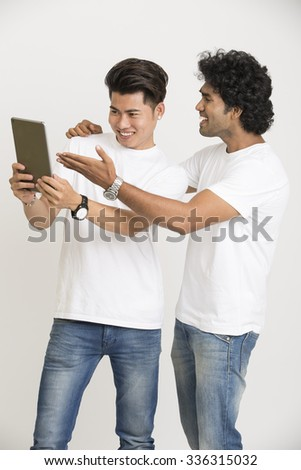 Cheerful face college students using digital tablet over white background - stock photo