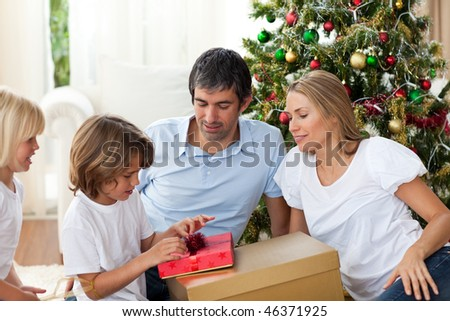 Cheerful family celebrating Christmas at home - stock photo