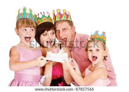 Cheerful family holding cake, isolated - stock photo