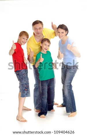Cheerful family in bright T-shirts have fun in the company of each other - stock photo