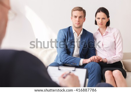 Cheerful family is consulting a psychotherapist - stock photo