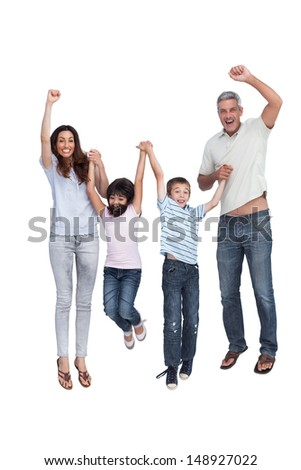 Cheerful family jumping against white background - stock photo