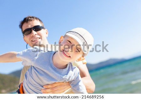 cheerful family of two having fun during vacation at lake tahoe, california, usa - stock photo