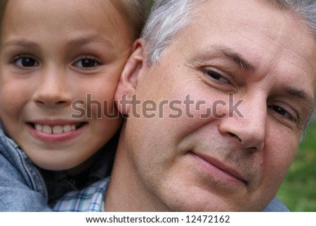 Cheerful father and daughter