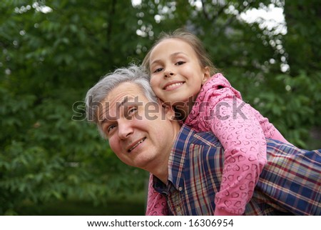 Cheerful father and daughter outdoors - stock photo