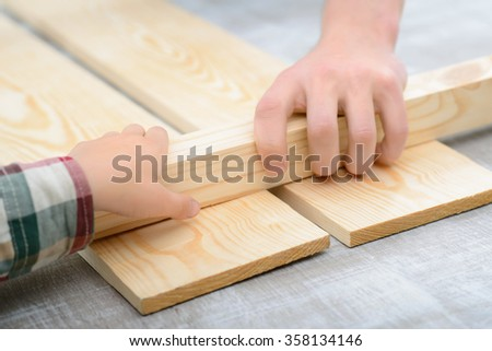 Cheerful father and son making renovation  - stock photo