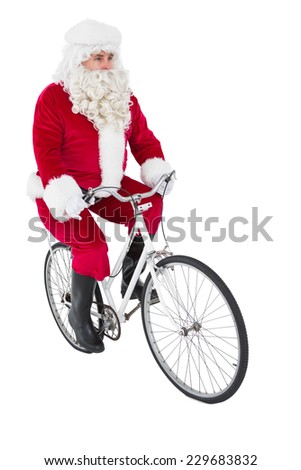 Cheerful father christmas cycling on white background - stock photo