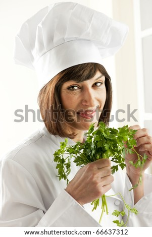 Cheerful Female Chef With Parsley