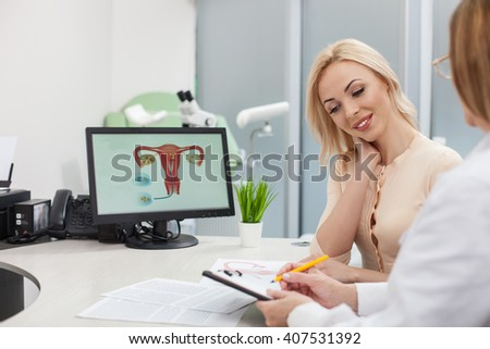 Cheerful female doctor is giving advice to lady - stock photo