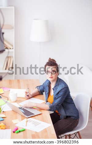 Cheerful female freelancer has a lot of work - stock photo