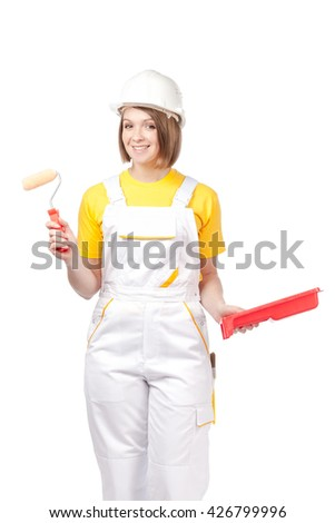 cheerful female painter or decorator with paint roller and tray isolated on white background