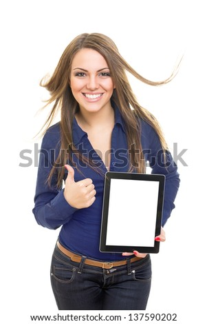 Cheerful female student showing digital tablet screen gesturing thumb up - stock photo