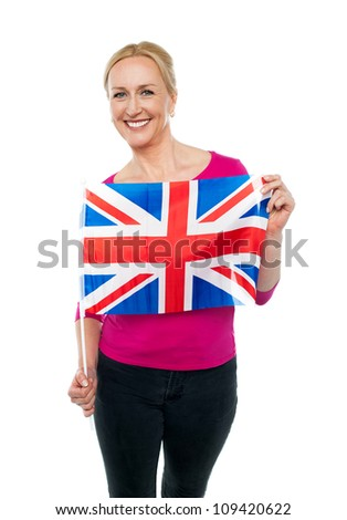 Cheerful female supporter holding national flag isolated against white background