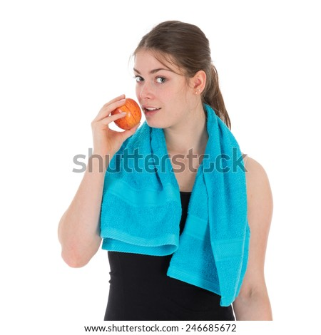 Cheerful fitness woman eating a red apple, isolated over white - stock photo