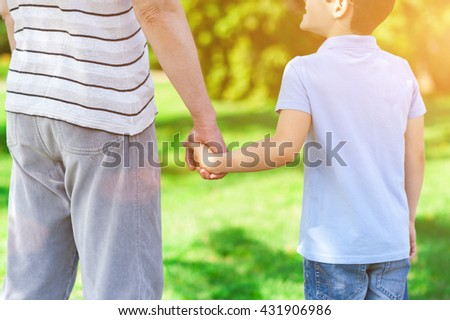 Cheerful friendly family is resting in the nature - stock photo