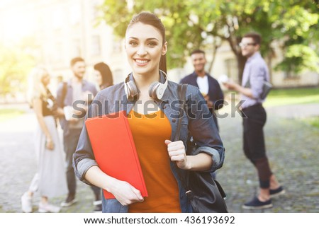 Cheerful friends are enjoying student life - stock photo
