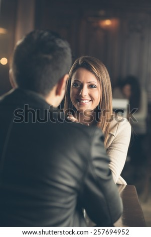 Cheerful friends at the bar having a coffee break - stock photo