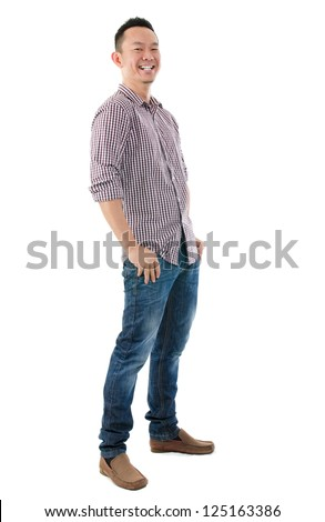 Cheerful full body Asian man standing  isolated on white background - stock photo