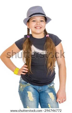 Cheerful , funny girl teen with long pigtails hat and pureed jeans , close-up-Isolated on white - stock photo