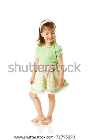 Cheerful girl dancing on floor isolated on white