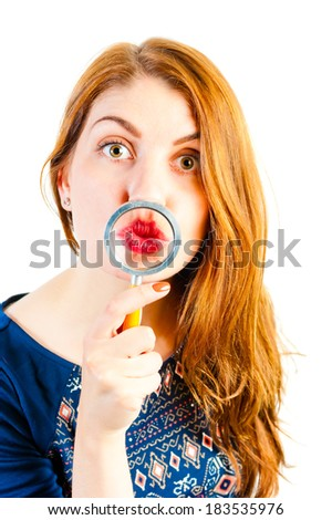 cheerful girl fooling around with a magnifying loupe - stock photo