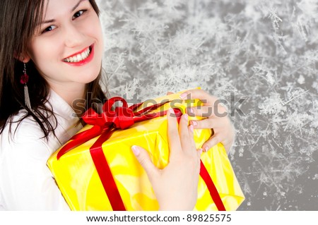 Cheerful girl holding present - stock photo