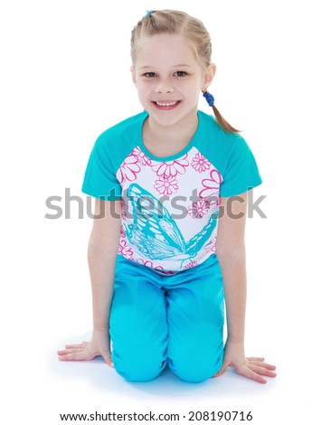 Cheerful girl in a tracksuit.kindergarten, the concept of childhood and joy, teens - stock photo