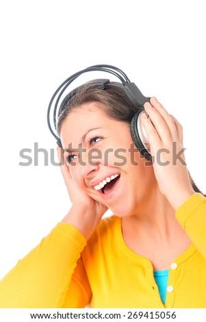 cheerful girl in big headphones listening to music - stock photo