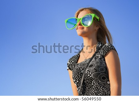 Cheerful girl In large sunglasses