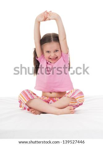 cheerful girl in sleepwear wake up - stock photo