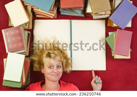 Cheerful girl showing the blank page of the book - stock photo