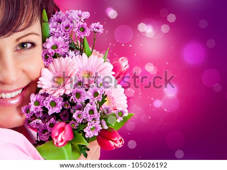 cheerful girl with a bouquet of pink flowers - stock photo