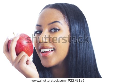 Cheerful girl with apple - stock photo