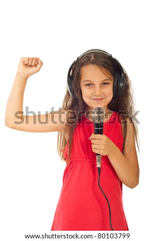 Cheerful girl with headphones singing into microphone isolated on white background - stock photo