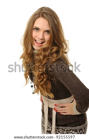 Cheerful girl with long hair in a warm dress - stock photo