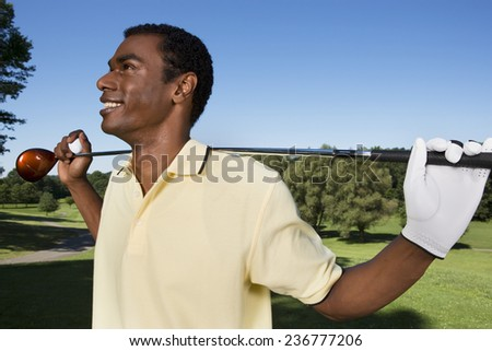Cheerful Golfer on Course - stock photo