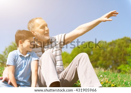 Cheerful grandfather is spending time with grandchild - stock photo