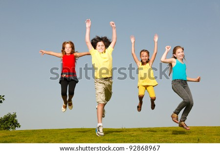 Cheerful group of children resting on the grass
