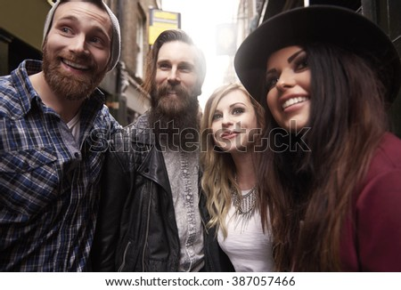 Cheerful group of friends in the city centre - stock photo
