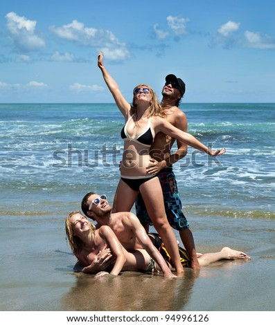 Cheerful group of people on the beach - stock photo
