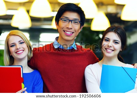 Cheerful group of students  - stock photo