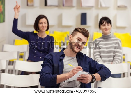 Cheerful guy and women are studying - stock photo